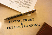 Image of living trust and estate planning document. A tax form is also included in the scene.